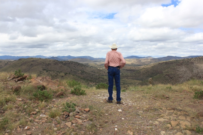 Fort Davis is a tiny, unincorporated town so deep in the mountains of Far West Texas, most Texans don't even know where it is. Jim Severns looks down on town and the old frontier fort from a favorite vantage point in Davis Mountains State Park.  Photo by Lindy C Severns.